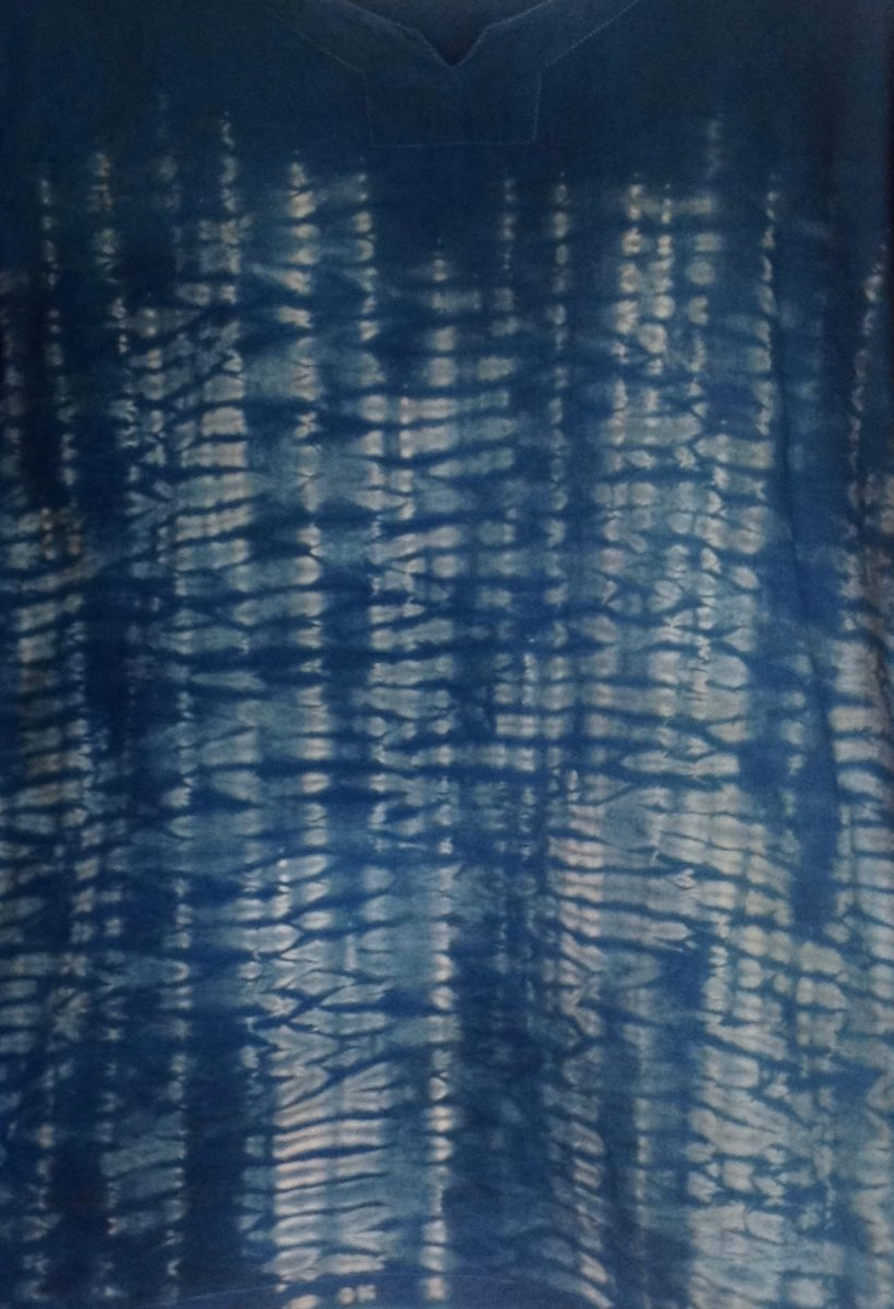 detail of Indigo and walnut natural dyes with nui shibori stitching on a cotton tunic