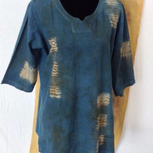 Front view of Indigo tunic with Nui shibori stitching and walnut, lac and madder natural dyes